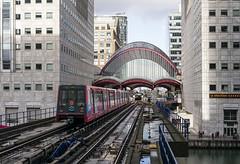 Between the  Towers (powern56) Tags: london docklands canarywharf docklandslightrailway dlr tfl transportforlondon b90 emu electricmultipleunit passengertrain lightrailway
