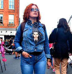 White, Red and Blue (Owen J Fitzpatrick) Tags: ojf people photography nikon fitzpatrick owen pretty pavement chasing d3100 ireland editorial use only ojfitzpatrick eire dublin republic city tamron candid joe candidphotography candidphoto unposed natural attractive beauty beautiful woman female lady j along photoshoot street 2018 dslr digital streetphoto streetphotography august 25 25th lobster festival dalkey shades sunglasses hair red rua redhead cans earphones denim tshirt illustration face visage fashion attire clothing thumbring thumb ring crucifix cross necklace wristwatch