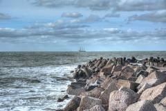 Ö (baerchen57) Tags: urlaub strand wasser nordsee wellen steilküste sand wolken segelboot segler schiff