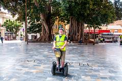 getting around (Tony Shertila) Tags: esp spain cartagena geo:lat=3760200075 geo:lon=098433316 geotagged murcia europe 20180402135616cruiseshipazoracatagenalr segway wheels tree tourist