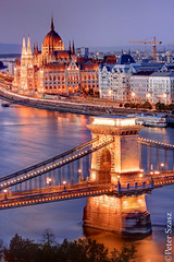 Budapest capitol lights (Peter Szasz) Tags: hungary magyarország budapest city cityscape night architecture smooth hdr parliament street lights trails long longexposure tranquil urban outside telephoto outdoors sky purple chill bridge chainbridge chain lánchíd széchenyi parlament river sunset water flow duna danube beautyful reflection travel capitol evening buildings arch pillars crane lamps