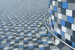 Blue, grey and white (Jan van der Wolf) Tags: map172233v tiles tegels patroon pattern blue blauw grey grijs art artwork kunst kunstwerk knokke depth depthoffield dof scherptediepte line lijn curve bar stang