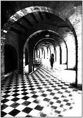 arches (kurtwolf303) Tags: monochrome bw sw arches bögen kurtwolf303 person olympusem1 omd microfourthirds mft micro43 arena palmademallorca mallorca spain spanien architektur architecture colisseubalear lightshadows