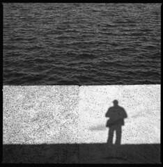 along the pier III (ukke2011) Tags: hasselblad503cw planarcfe8028 rolleirpx25 rodinal 150 film pellicola 120 square 6x6 bw blackandwhite bianconero monochrome mediumformat analog analogico pier molo sea mare shadow ombra