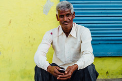 Indian Man & Yellow Wall (AdamCohn) Tags: adam cohn uttar pradesh india mathura vrindavan friends holi man men street streetphotography wwwadamcohncom adamcohn uttarpradesh