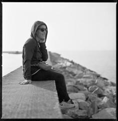 smiling along the pier (ukke2011) Tags: hasselblad503cw planarcfe8028 spur50dsx agfa copex rodinal 150 film pellicola 6x6 120 square bw monocrome blackandwhite bianconero analogico analog portrait ritratto pier molo