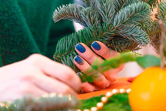 A girl makes a bouquet (zoom_machine) Tags: christmas newyear floristry bouquet decoration wreath glue collectbouquet composition flowers tree branches christmasdecorations create pine holiday holly red new year design winter green color interiordecoration manicure nails hand women girl