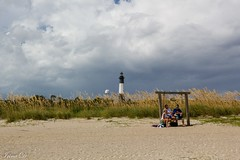 Between the sky and the ocean (Irina1010) Tags: beach sand dunes vegetation lighthouse sky clouds stormy people swing landscape nature beautiful tybeeisland savannah canon reeds outstandingromanianphotographers
