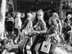 Rituals (d_t_vos) Tags: girls women woman bag rituals scooter shop shopwindow shopping people bw dof shiny street streetphotography streetcandid candid wirdumerdyk leeuwarden busy zwartwit schwarzweiss noireetblanc sunglasses naturallight watchingme eyecontact dickvos dtvos