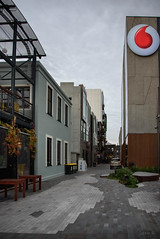 Parked Up (Jocey K) Tags: newzealand nikond750 christchurch sky building architecture clouds car logo bar rebuild cbd