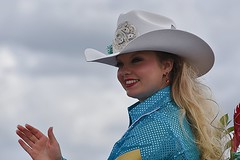 Rodeo Queen (Scott 97006) Tags: woman ride hat wave smile pretty cowgirl