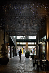 Silhouettes (Jocey K) Tags: newzealand nikond750 christchurch allyway plants pots lights silhouettes rebuild building door cbd people tables chairs