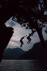 Jump (Rod Waddington) Tags: vietnam vietnamese lake water jump people mountains trees rocks outdoor action clouds landscape