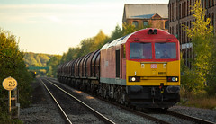 DBC Class 60 no 60011 at Ilkeston Station on 27-09-2018 with the Wolverhampton to Immingham Steel Containers (kevaruka) Tags: ilkeston derbyshire station evening twilight trains train transport autumn september 2018 colour colours color colors flickr thephotographyblog frontpage telephoto telephototrains dof depth bokeh england class66 class60 class 43 canon canoneos5dmk3 canon5dmk3 canon70200f28ismk2 5d3 5diii 5d 5dmk3 red yellow 60011