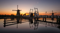 Kinderdijk sunset (reinaroundtheglobe) Tags: kinderdijk unesco worldheritage reflections waterreflections wind traditionalwindmill dutchlandscape landscape sunset holland netherlands