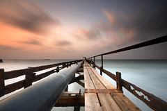 Enjoy the silence (FX-1988) Tags: sea water ocean dock long exposure clouds time fog black white wide beach israel landscape waterscape golden hour sunset movment
