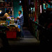 Man making a purchase in Warorot Market in Chiang Mai, Thailand