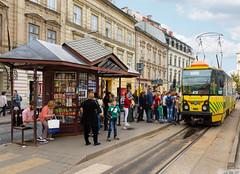 L'arrêt de tram de la Place de l'église (Vincent Rowell) Tags: sobornasquare people tram ukraine2018 ukraine lviv photoshopped raw