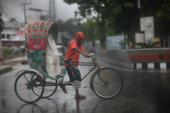 Red Rain Rush (N A Y E E M) Tags: rickshawwalla red rain monsoon afternoon colors candid street norahmedroad chittagong bangladesh sooc raw unedited untouched windshield