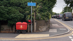 I'm A Little Vehicle (M C Smith) Tags: post wheels pavement bushes green hill traffic red silver yellow van pentax k3 lines white tactilepaving church spire lamps grey sky wall leaves brick brown letters symbols numbers flowers purple