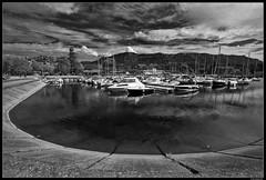 Aix-les-Bains #1 (LilFr38) Tags: lilfr38 fujifilmxpro2 fujifilmfujinonxf1024mmf4rlmois savoie aixlesbains france blackwhite noirblanc lake boat reflection sky cloud lac bateau reflet ciel nuage lettingthecablessleepbush