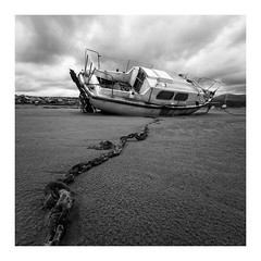 Boat (wwarby) Tags: llandanwg wales abandoned abroad beach blackandwhite boat bordered chain dramatic estuary favourites holiday holiday2018llandanwg landscape old outdoors perspective portfolio sand stranded vacation