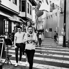 top of the world (zeNat Photography) Tags: streetlife urbanlife bnw diesel urban couple baloon dad daughter street streetphotography monochrome blackandwhite