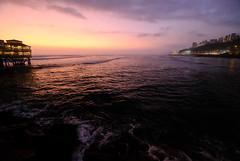 Sunset in Lima, Peru (` Toshio ') Tags: toshio lima peru southamerica jetty larosanautica sunset nature miraflores cliffs shoreline beach waves pacific pacificocean ocean fujixt2 xt2 clouds