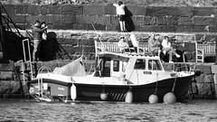 North Berwick, autumn day 014 (byronv2) Tags: northsea northberwick firthofforth forth rnbforth river riverforth sea coast coastal eastlothian scotland autumn peoplewatching candid street boat fishingboat blackandwhite blackwhite bw monochrome