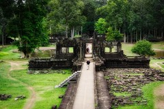 Causeway leading to Baphuon temple ruins in the ancient city of Angkor Thom near Siem Reap, Cambodia (UweBKK (α 77 on )) Tags: angkor thom archeological park ancient history historical city temples ruins archeology siem reap cambodia southeast asia sony alpha 77 slt dslr bapuon baphuon pavilion causeway trees forest stones grass
