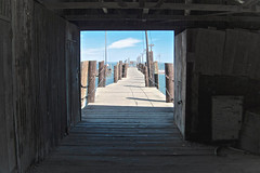 China Camp Village Pier (sswj) Tags: architecturaldetail chinacamp pier historicbuilding chinacampstatepark scottjohnson leica dlux4 availablelight naturallight existinglight composition shadowtolight bay sanpablobay marincounty sanrafael abstractreality weathered cloud boats nautical dock olddock historicdock chinacampvillage