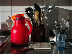 Morning (Anne Worner) Tags: stilllife ricohgr thermos glass waterglass pottery pan panlid shadows tiles counter eggs paintedtile spatula spoon whisk kitchenutensils kitchen anneworner red