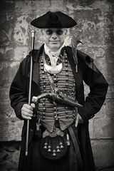 Portrait from Lincoln's Asylum X Steampunk Festival (Gordon.A) Tags: lincolnshire lincoln exchequergate asylum x asylumx steampunk steam punk weekend convivial lincolnasylum lincolnasylumsteampunk festival festiwal festivaali festivalen festspiele alternative victorian neovictorian fashion culture subculture costume creative hat tricorne gun pistol weapon man face people event eventphotography amateur street photography day daylight outdoor outdoors outside town city urban wall pose posed posing naturallight portrait mono monochrome monochromatic monotone blackandwhite bnw bw digital canon eos 750d sigma sigma50100mmf18dc