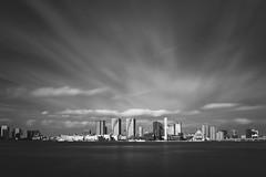 Harumi Skyline (Bunaro) Tags: harumi district tokyo japan asia nippon nihon clouds sky longexposure monochrome water sea ocean waterscape landscape seascape cityscape blackandwhite canon m50