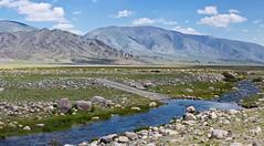 Driving towards Bayan Olgii, Mongolia (Miche & Jon Rousell) Tags: mongolia altaitavanbogdnationalpark tsagaangol whiteriver altai
