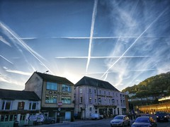 IMG_20180924_075004-01.jpeg (aderixon) Tags: road traffic morning sky blue contrails town suburban architecture