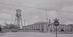 Factory Tank  on Tri-X Film (Neal3K) Tags: trix35mm nikons335mmfilmcamera griffinga georgia rr railroad watertank watertower stopsign rrsignal experimentstreet
