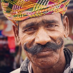 Indian eyes. Reflection of his soul. (F Image Gallery) Tags: india portrait moustache travel orange eyes mustache ojos bigote rajasthan