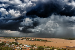 Clouds over Mekong (rvjak) Tags: mytho vietnam sky clouds nuages asia asie sudest southeast d750 nikon river rivière mekong boats bateaux muddy landscape