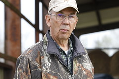 Ray Coleman walks around his brother in-law's farm. He grew up in Greensboro, leaving to go to school at the University of Georgia. But he came back after to work, and eventually own cows after retirement, which he says has always been his true passion.