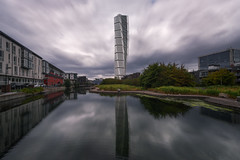 Turning Torso (Malmö) (protsalke) Tags: malmö turningtorso calatrava sky clouds tower waterscape urbanscape reflections water architecture urban city