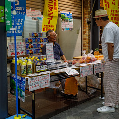 The Chat (USpecks_Photography) Tags: vendor streetphotography chat conversation interest shopkeeper tokyo japan market