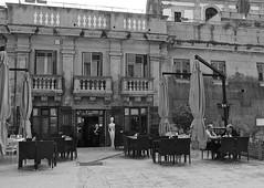 Palermo (Adel Ka) Tags: bw blackandwhite monochrome street streetphotography candid people streetview statue waiter cafe two men talking sicily sicilia city life white lady grainy