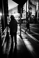 Urban Cowboy (Kieron Ellis) Tags: man cowboyhat hat shadow light contrast glass reflections road pavement trafficlight car candid street blackandwhite blackwhite monochrome