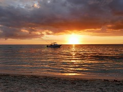 Golden suset (lesleydugmore) Tags: mauritius sunset gold golden boat indianocean sea sand beach sky cloud colour orange outside outdoors lemorne