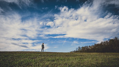 Skies above (BalintL) Tags: green grass blue sky clouds tree trees forest field girl horizon stand standing autumn nature rural landscape uwa samyang 12mm f2 fujifilm xt20