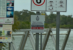 Border watch (Dreaming of the Sea) Tags: sign water elloitriver tamronsp2470mmf28divcusd nikond7200 2018 trees bundaberg queensland australia jetty riverview