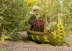 Voyageur (Karen_Chappell) Tags: travel nature sculpture art flowers plants canada gatineau ottawa green canoe people
