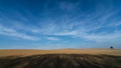 (crosslens) Tags: field sky sand shadow landscape hide stance stand raisedblind raisedhide
