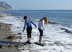 Fun in the sun (jo92photos) Tags: beach sun sunshine playing funinthesun waves tide water splashing wet siblings children coast seaside